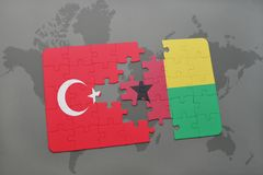 Puzzle with the national flag of turkey and guinea bissau on a world map. Background. 3D illustration royalty free stock photography