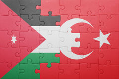 Puzzle with the national flag of turkey and jordan Royalty Free Stock Images