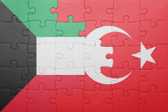 Puzzle with the national flag of turkey and kuwait. Concept stock photography