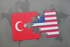 Puzzle with the national flag of turkey and liberia on a world map. Background. 3D illustration royalty free stock photography