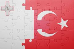 Puzzle with the national flag of turkey and malta. Concept Royalty Free Stock Image