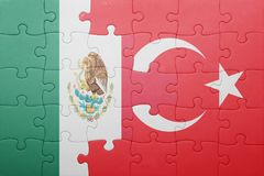 Puzzle with the national flag of turkey and mexico. Concept royalty free stock photo