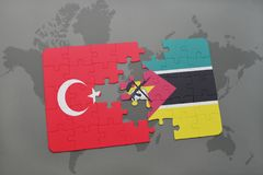 Puzzle with the national flag of turkey and mozambique on a world map. Background. 3D illustration Stock Image