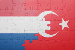 Puzzle with the national flag of turkey and netherlands. Concept stock image