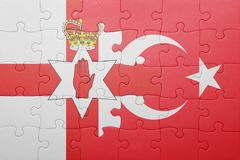 Puzzle with the national flag of turkey and northern ireland Royalty Free Stock Photo