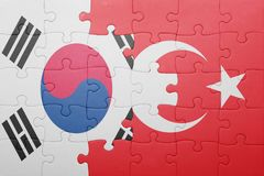 Puzzle with the national flag of turkey and south korea. Concept royalty free stock photos