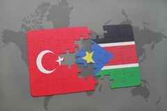 Puzzle with the national flag of turkey and south sudan on a world map. Background. 3D illustration royalty free stock photography