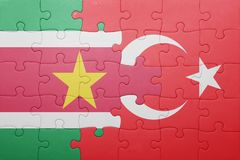 Puzzle with the national flag of turkey and  suriname Royalty Free Stock Photos
