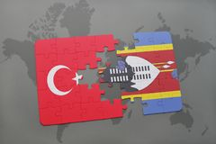 Puzzle with the national flag of turkey and swaziland on a world map. Background. 3D illustration royalty free stock photos