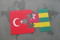 Puzzle with the national flag of turkey and togo on a world map. Background. 3D illustration royalty free stock images