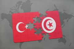 Puzzle with the national flag of turkey and tunisia on a world map. Background. 3D illustration royalty free stock images