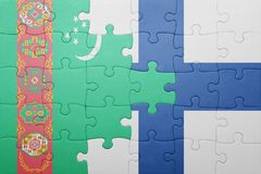 Puzzle with the national flag of turkmenistan and finland Stock Images