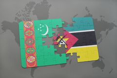 Puzzle with the national flag of turkmenistan and mozambique on a world map Royalty Free Stock Images
