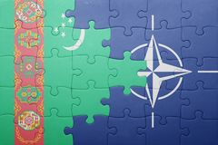 Puzzle with the national flag of turkmenistan and nato Royalty Free Stock Image