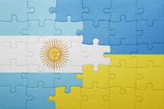 Puzzle with the national flag of ukraine and argentina Stock Photo