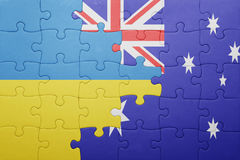 Puzzle with the national flag of ukraine and australia. Concept Stock Image