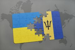 puzzle with the national flag of ukraine and barbados on a world map Royalty Free Stock Photo