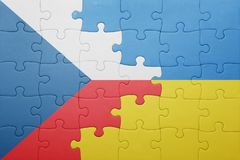 Puzzle with the national flag of ukraine and czech republic. Concept Royalty Free Stock Photo
