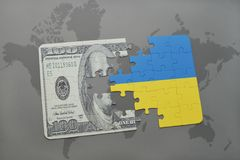 puzzle with the national flag of ukraine and dollar banknote on a world map background. Royalty Free Stock Images