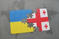 Puzzle with the national flag of ukraine and georgia on a world map background. 3D illustration Royalty Free Stock Photo