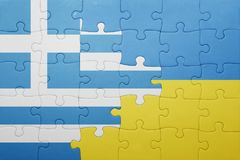Puzzle with the national flag of ukraine and greece Royalty Free Stock Images