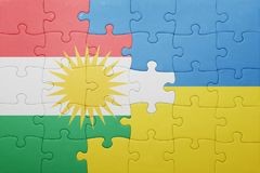 Puzzle with the national flag of ukraine and kurdistan. Concept Royalty Free Stock Photos