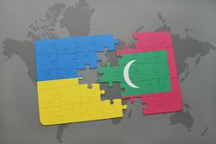 Puzzle with the national flag of ukraine and maldives on a world map. Background. 3D illustration Stock Images