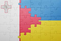 Puzzle with the national flag of ukraine and malta. Concept Stock Photography