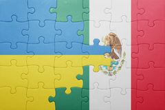 Puzzle with the national flag of ukraine and mexico. Concept stock image