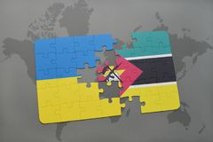 Puzzle with the national flag of ukraine and mozambique on a world map. Background. 3D illustration Stock Images