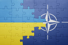 Puzzle with the national flag of ukraine and nato Royalty Free Stock Photos