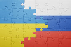 Puzzle with the national flag of ukraine and russia. Concept Royalty Free Stock Photos