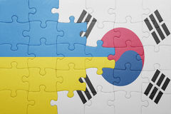 Puzzle with the national flag of ukraine and south korea. Concept royalty free stock images