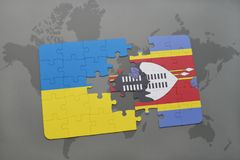 Puzzle with the national flag of ukraine and swaziland on a world map Royalty Free Stock Photo