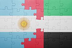 Puzzle with the national flag of united arab emirates and argentina Royalty Free Stock Photos