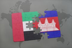 puzzle with the national flag of united arab emirates and cambodia on a world map background. Stock Image