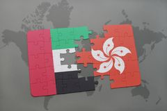 Puzzle with the national flag of united arab emirates and hong kong on a world map background. 3D illustration Stock Photos