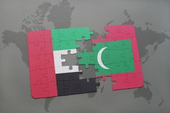 Puzzle with the national flag of united arab emirates and maldives on a world map background. 3D illustration Stock Image