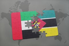 Puzzle with the national flag of united arab emirates and mozambique on a world map Stock Photos