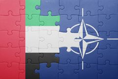 Puzzle with the national flag of united arab emirates and nato. Concept stock images