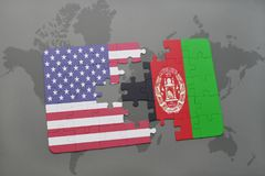 Puzzle with the national flag of united states of america and afghanistan on a world map background Royalty Free Stock Image