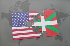 Puzzle with the national flag of united states of america and basque country on a world map background. Concept Royalty Free Stock Photography