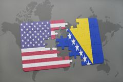 Puzzle with the national flag of united states of america and bosnia and herzegovina on a world map background. Concept Stock Photo