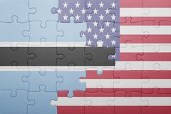 Puzzle with the national flag of united states of america and  botswana Stock Photos