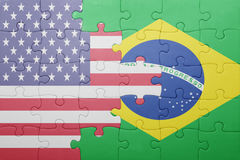 Puzzle with the national flag of united states of america and brazil royalty free stock photo