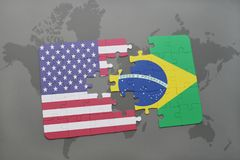Puzzle with the national flag of united states of america and brazil on a world map background. Concept Stock Photography
