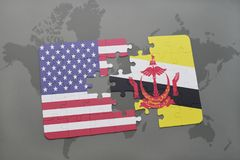 Puzzle with the national flag of united states of america and brunei on a world map background. Concept Royalty Free Stock Photo