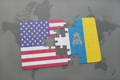 Puzzle with the national flag of united states of america and canary islands on a world map background. Concept stock photography