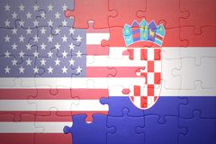 Puzzle with the national flag of united states of america and croatia. Concept Royalty Free Stock Photos
