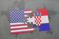 Puzzle with the national flag of united states of america and croatia on a world map background. Concept royalty free stock images